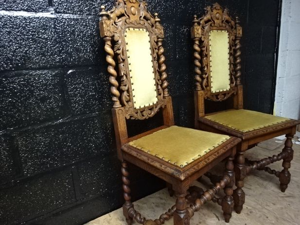 A pair of heavily carved oak barley twist chair's with studded yellow upholstery